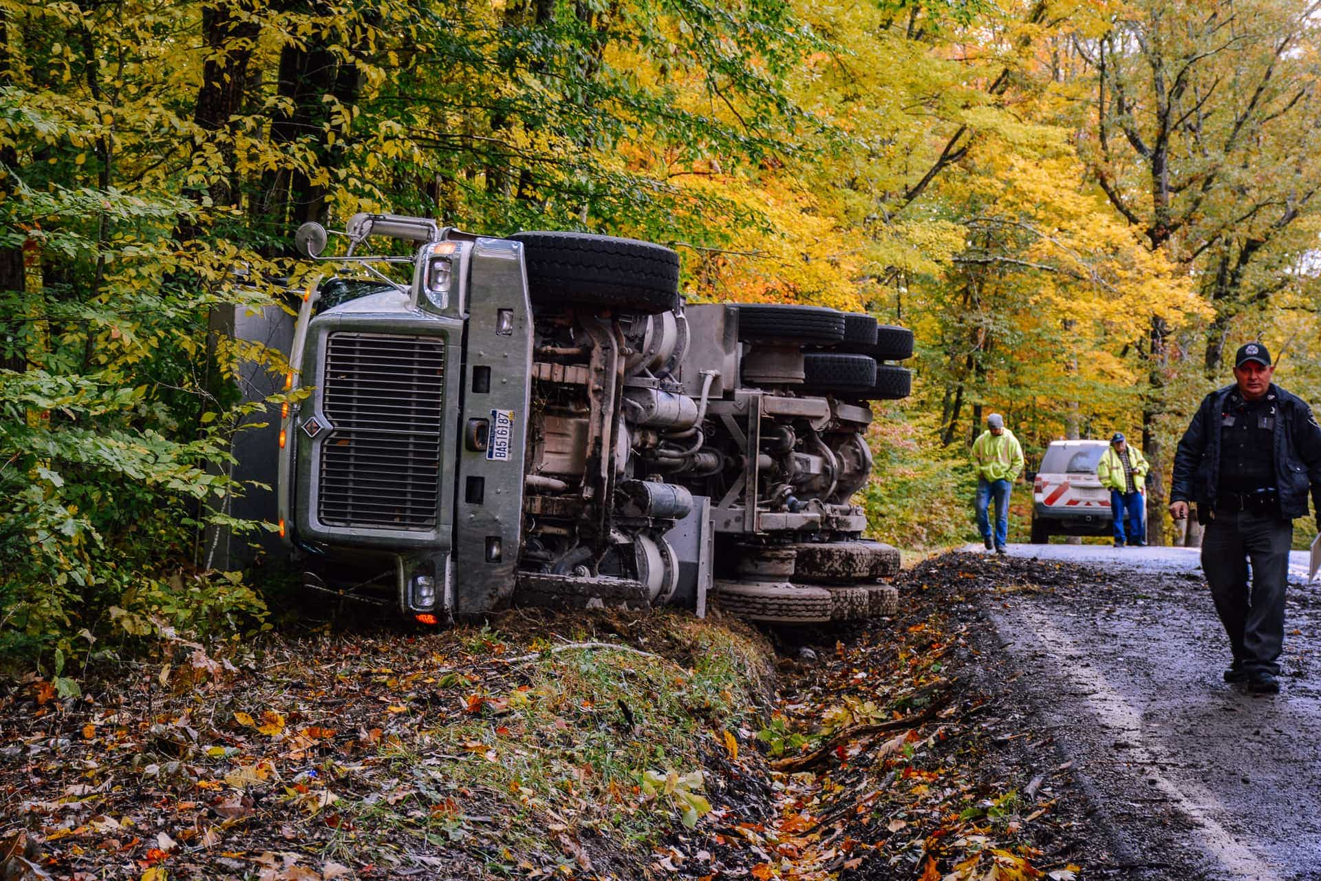 Updated: Asphalt truck rollover caused by rear wheel snag