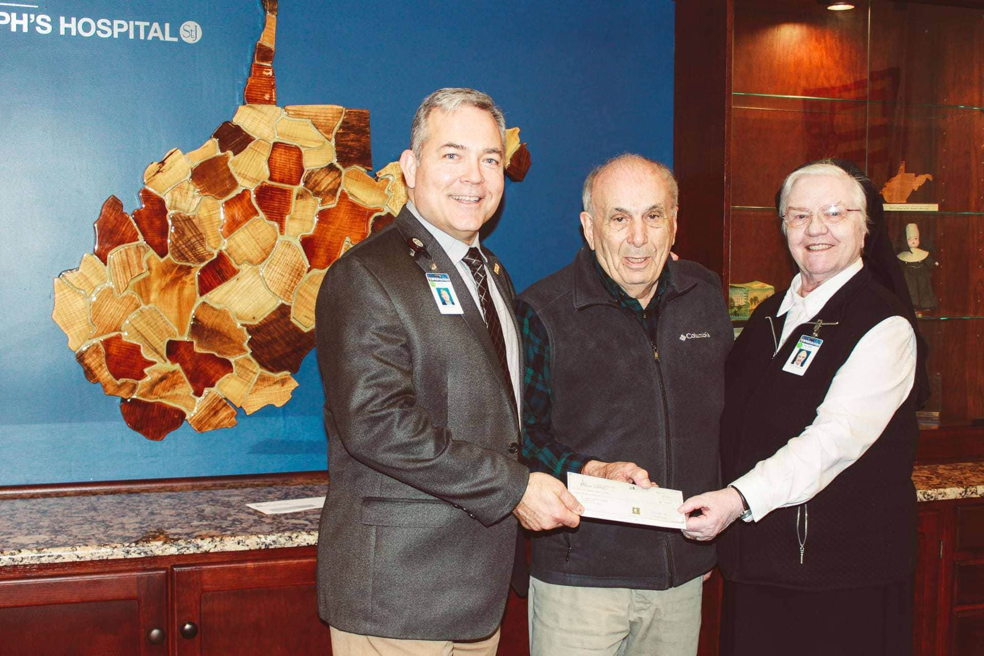 Mike Ross makes donation to St. Joseph's Hospital for new nurse call system