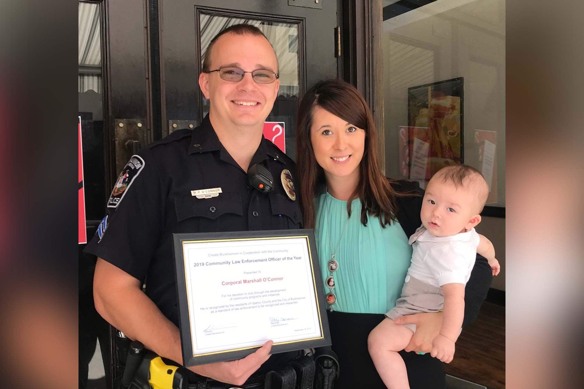 Buckhannon Police Officer Corporal Marshall O'Connor, wife, Tiffany O'Connor, and son, Jayden.