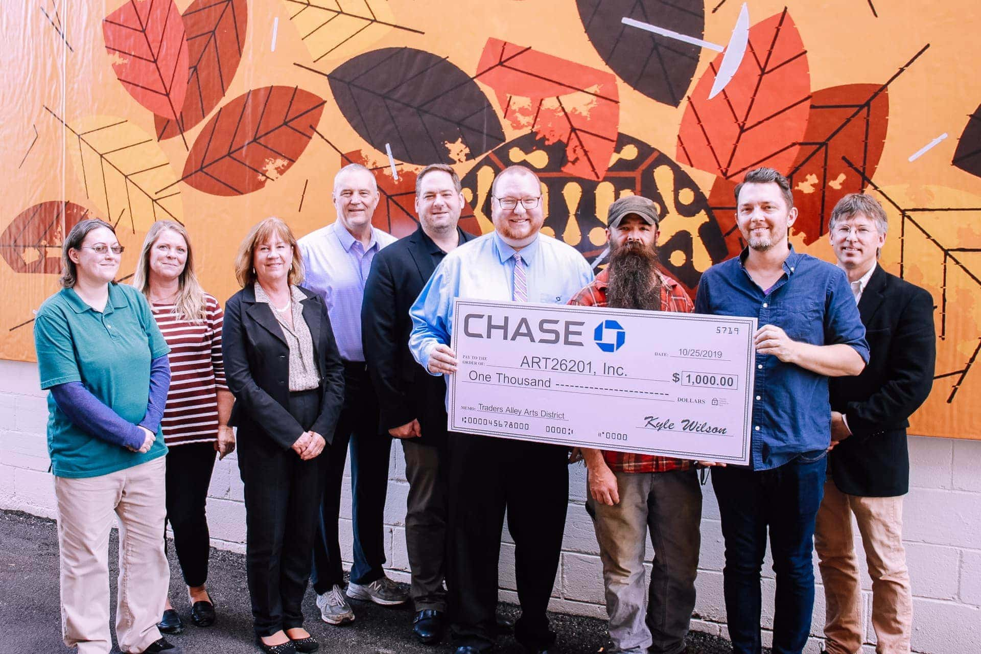 Kyle Wilson of Chase Bank (center) presents the donation to ART26201 members Allison Corbin, Virginia Hicks, Lisa Wharton, C.J. Rylands, and John Waltz, on left, and Tim Hibbs, Bobby Howsare, and Bryson VanNostrand on right.