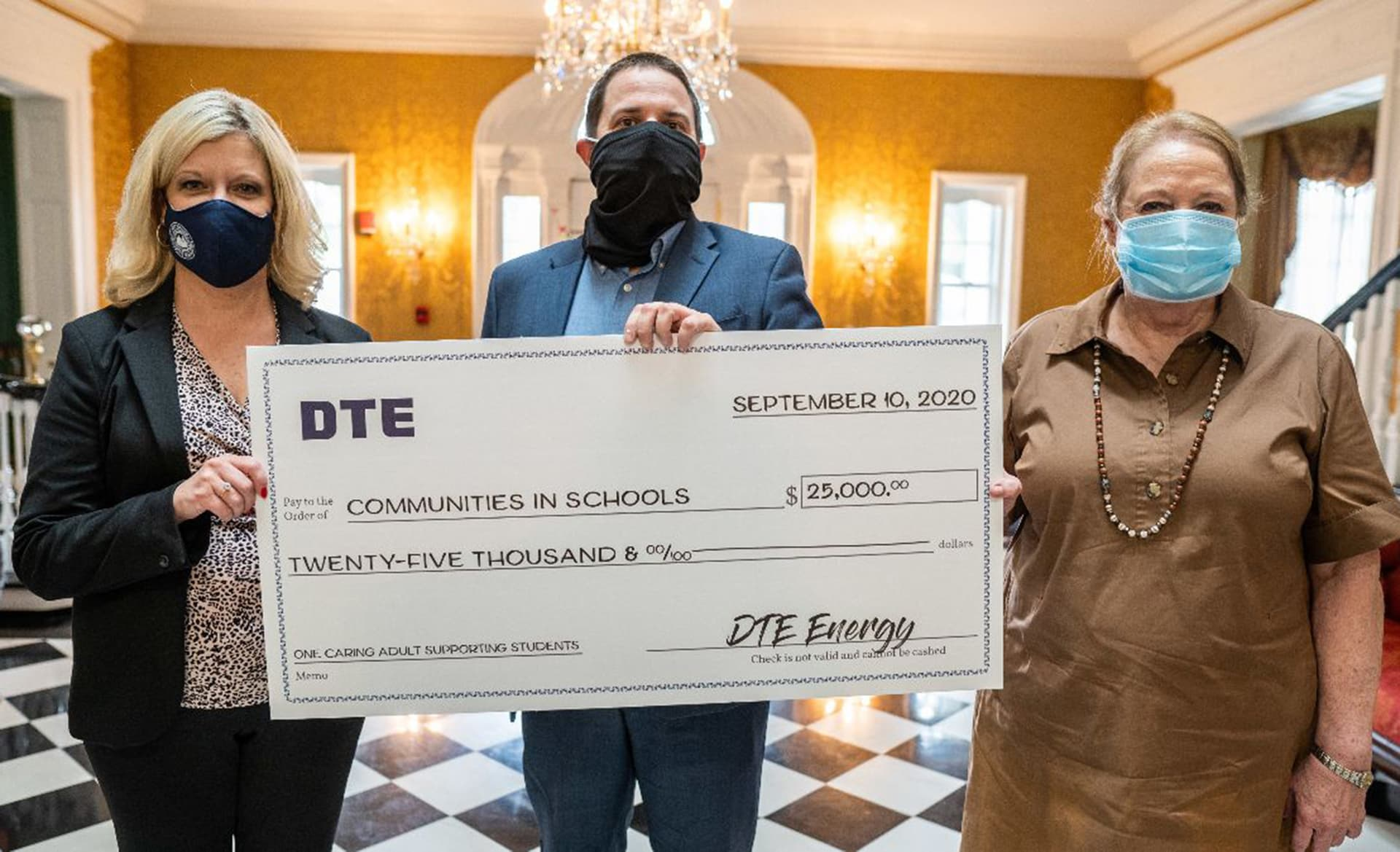 First Lady Cathy Justice accepts $25,000 check from DTE Energy in support of Communities In Schools program