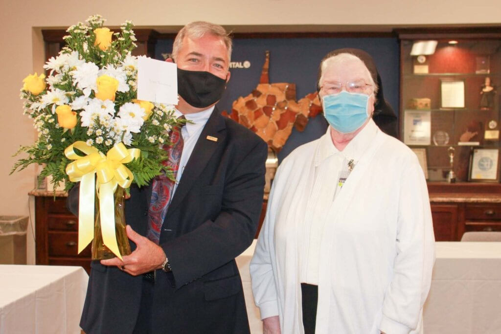 Skip Gjolberg, President of St. Joseph's Hospital, honors Sister Francesca Lowis, SAC at a celebration of her 60th Jubilee.