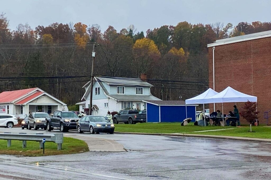 Cars form a line for COVID-19 testing at Buckhannon-Upshur Middle School on Sunday.