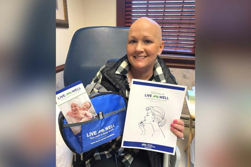 Crystal Chidester of Buckhannon receives the first LiveWell makeup kit from the Cancer Care Center, a part of Davis Medical Center.