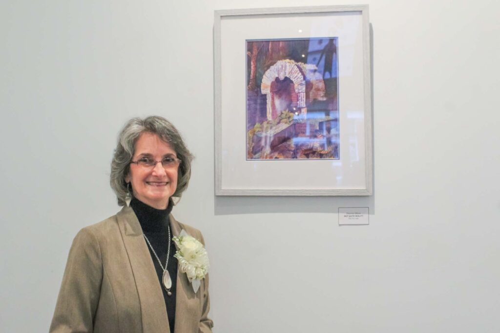 Buckhannon artist Deanna Gillum at the opening of her solo watercolor exhibit. The exhibit will be open Fridays and Saturdays from 4 p.m. to 8 p.m. through Feb. 6 at the Colonial Theater Gallery on Main Street.