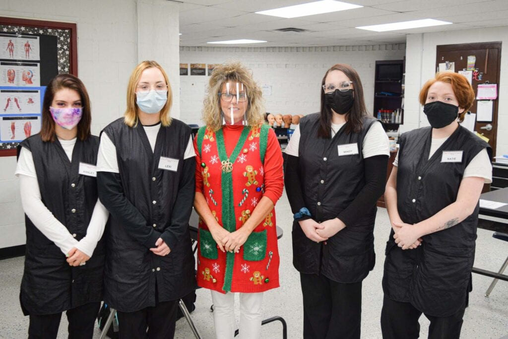 Fred Eberle Technical Center cosmetology coordinator Mary Hull is pictured with cosmetology students Ashley White, Lexy Wildman, Mindy Hayes and Katie Smith.
