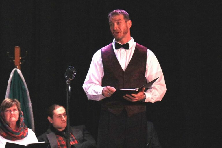 Glenville State College Assistant Professor of Criminal Justice Dr. Donal Hardin at the microphone at a previous reader's theater production. The Glenville State College Players will perform Arthur Miller's All My Sons at GSC, April 22-24.