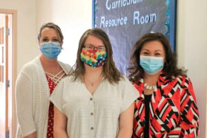 Dr. Shelly Ratliff, Morgan Golden, and Connie Stout O'Dell outside the recently opened Curriculum Resource Center at Glenville State College.