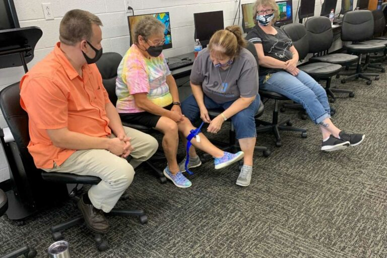 Webster County School staff practice applying tourniquets as part of Stop the Bleed training. (Photo courtesy EMD Liaison Shawn Dunbrack.)