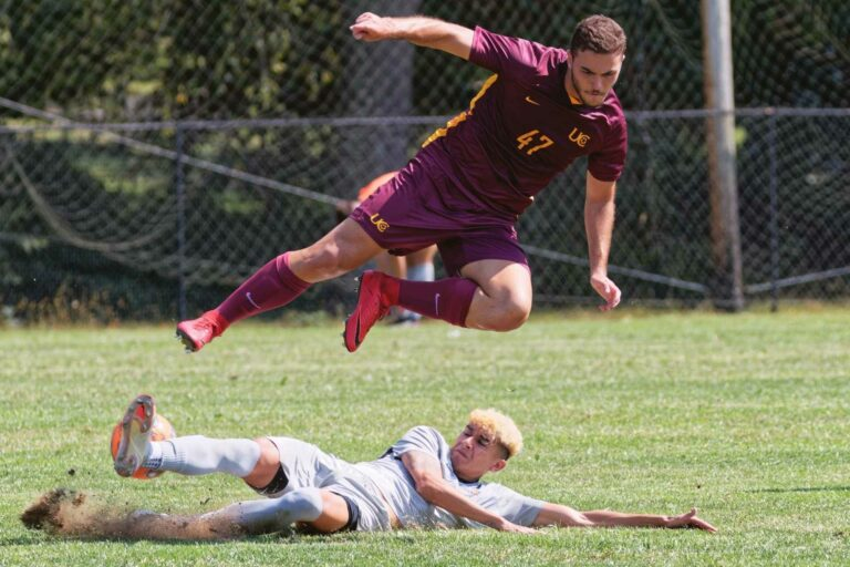 Luis Diaz wins the ball with a slide tackle during Sunday's skirmish with Charleston. (Brian Bergstrom/My Buckhannon)